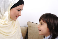 Muslim mother and son relaxing royalty free stock photo