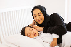 Muslim mother son sleeping Royalty Free Stock Photos