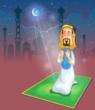 Muslim offering namaaz on Eid Royalty Free Stock Image