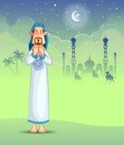 Muslim offering namaaz on Eid Stock Images