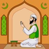Muslim offering namaaz on Eid Stock Photos
