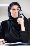 Muslim office worker holding phone Royalty Free Stock Image