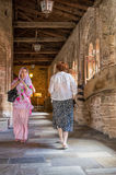 A muslim and an orthodox woman meet peacefully in a monastery Royalty Free Stock Images