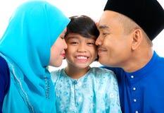Kiss. Muslim parent kiss their daughter Royalty Free Stock Photo