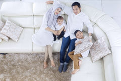 Muslim parents and children relaxing on sofa Stock Photography