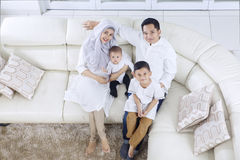 Muslim parents and children sitting on sofa Royalty Free Stock Photos