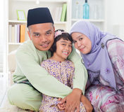 Muslim parents hugging child Stock Images
