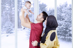 Muslim parents playing with their boy at home Stock Photos