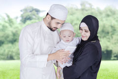Muslim parents showing cellphone to their boy Royalty Free Stock Images