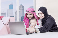 Muslim parents and son looking laptop Royalty Free Stock Photography