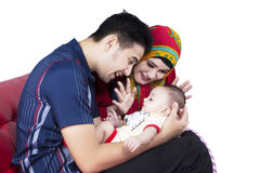 Muslim parents and son on sofa together Royalty Free Stock Photography