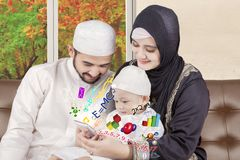 Muslim parents teaching boy with smartphone Royalty Free Stock Image