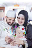 Muslim parents use technology for education Royalty Free Stock Images