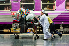 Muslim passengers and luggage to the train. Stock Image