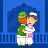 Muslim people hugging and wishing Eid Stock Photography