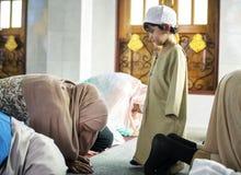 Muslim people praying in Sujud posture stock photos