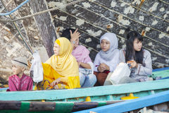 Muslim people sitting in the boat Stock Photo