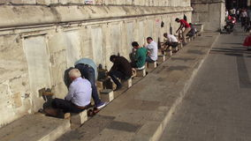 Muslim people wudu for pray in front of the mosque stock footage