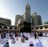 Muslim performing tawaf at holy Kaabah in the morning. Muslims face the direction of Kaaba when performing prayer royalty free stock image