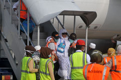 Muslim pilgrims arrived in Indonesia after finished the annual haj Royalty Free Stock Photo