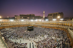 Muslim pilgrims circumambulate the Kaaba Stock Images