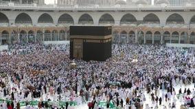 Muslim pilgrims circumambulating the Kaabah. Counter clockwise seven rounds in Masjidil Haram, Mecca, Saudi Arabia stock video