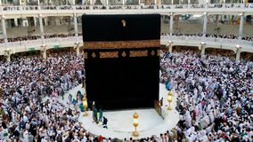 Muslim pilgrims circumambulating the Kaabah. A fast forwarded footage of Muslim pilgrims circumambulating the Kaabah counter clockwise seven rounds in Masjidil stock footage