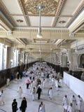 Muslim pilgrims perform saei' (brisk walking) Stock Photos