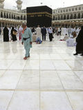 Muslim pilgrims walk on after light drizzle Stock Photo