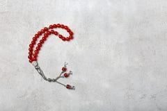 Muslim prayer beads. On gray background Stock Photo