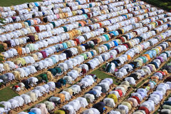 Muslim prayer. A group of Muslim are praying. They weared different color dress Stock Images