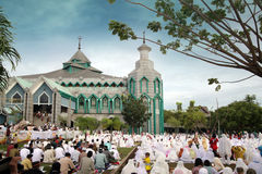 Muslim prayers. Muslim pray at idul fitri or Eid al-Adha, Muslim holiday that marks the end of Ramadan. Located at indonesia south east asia Royalty Free Stock Photo