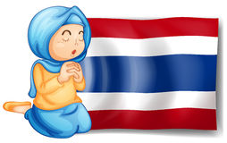 A muslim praying in front of the Thailand flag Stock Photo