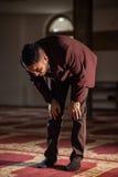 Muslim praying. Humble Muslim man praying peacefully in a gorgeous Mosque Royalty Free Stock Photos