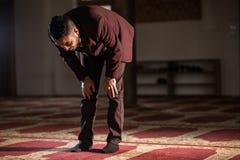 Muslim praying. Humble Muslim man praying peacefully in a gorgeous Mosque Royalty Free Stock Photo