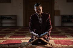 Muslim praying. Humble Muslim man praying peacefully in a gorgeous Mosque Royalty Free Stock Photography