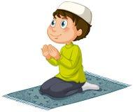 Muslim. Praying on a mat Royalty Free Stock Photography