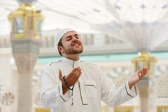 Muslim praying at Medina mosque Stock Photos