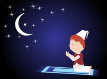 Muslim praying in the moon night on the mat Stock Images