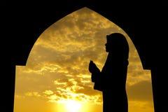 Muslim praying in mosque royalty free stock photo