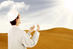 Muslim praying outdoor Stock Images