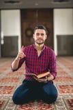 Muslim praying. Young attractive young man praying humbly Stock Photos