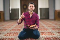 Muslim praying. Young attractive young man praying humbly Royalty Free Stock Photos