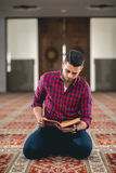 Muslim praying. Young attractive young man praying humbly Stock Images