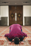 Muslim praying. Young attractive young man praying humbly Royalty Free Stock Images