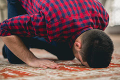 Muslim praying. Young attractive young man praying humbly Stock Photo