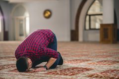 Muslim praying. Young attractive young man praying humbly Royalty Free Stock Image