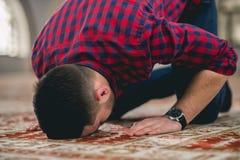 Muslim praying. Young attractive young man praying humbly Royalty Free Stock Photo