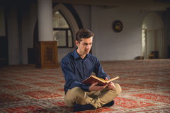 Muslim praying. Young Muslim man praying in a mosque Stock Photos
