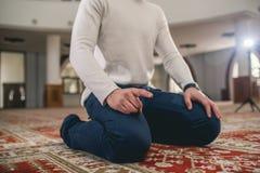 Muslim praying. Young Muslim man praying in mosque Stock Images